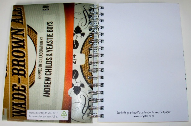 Inside view of the recycled poster notebooks featuring Celia Wade-Brown Ale