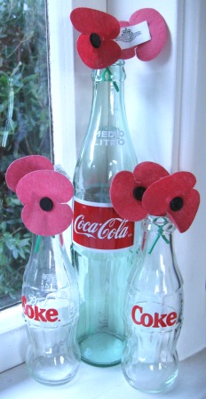 Old Coke bottle used to display ANZAC day poppies
