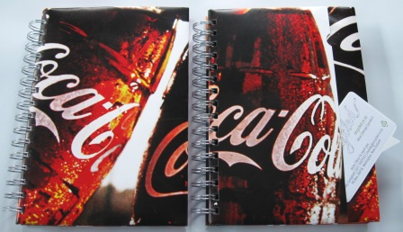 Recycled poster notebooks from a Campaign by Coca Cola in support of the Olympics