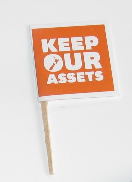Keep Our Assets flyers recycled into little flags to keep the movement alive