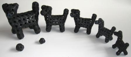 Recycled inner tube dogs from moutain bikes to roadie racers.