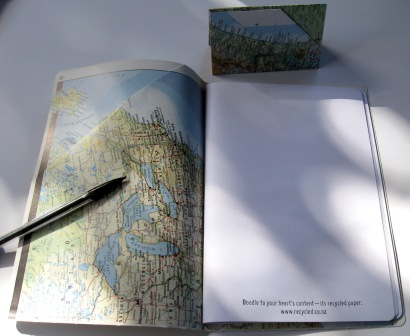 Recycled notebooks and card holders made from outdated maps